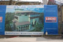 Bannerul care anunta asocierea Locic-biserica