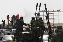 Rebelii sarbatoresc alungarea fortelor lui Gaddafi