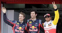 Mark Webber (centru), pole position la Barcelona