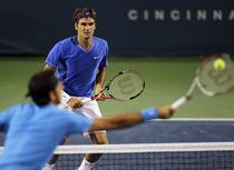 Federer, victorie la Del Potro