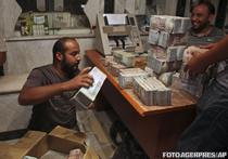 A inceput vanatoarea dupa banii lui Gaddafi