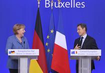 Sarkozy si Merkel, zimbet cu subinteles
