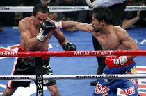 Manny Pacquiao (dreapta), victorie impotriva lui Juan Manuel Marquez