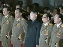 Kim Jong-Un si unchiul sau Jang Song-thaek (stanga)