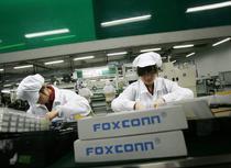 Intr-o fabrica Foxconn unde se produce iPad-ul