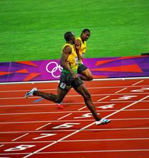Bolt ii face semnul tacerii lui Blake, la finisul olimpic de la 200m