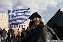 "Inscriptia de pe steag: ""Greci furiosi impotriva coruptiei"""