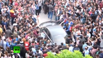 Masina premierului turc Erdogan, atacata de protestatari