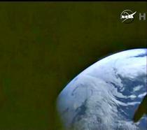 Pamantul, in departare, vazut din capsul Orion