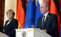 Vladimir Putin si Angela Merkel