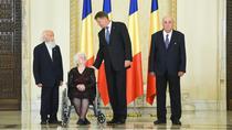 Trei fosti detinuti politici, decorati de Klaus Iohannis
