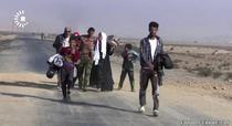Familie fugind din Mosul
