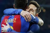 Lionel Messi si Luis Suarez