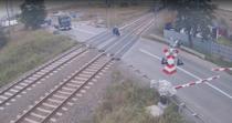 Motociclist in fata trenului