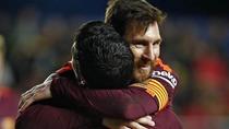 Suarez si Messi