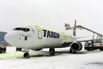 Avion TAROM iarna, pe aeroportul Otopeni