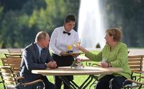 Angela Merkel si Vladimir Putin (foto arhiva)