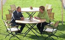 Merkel discuta cu Putin