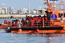 Migranți din Libia
