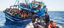 Migranți pe coasta libiană