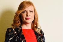 Elisa Rusu, Omnicredit