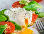 Poached eggs and veggies on toast