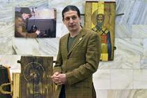Oleksandr Klymenko alaturi de una din icoanele sale