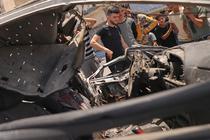 Masina lovita de tirurile israeliene in Gaza City